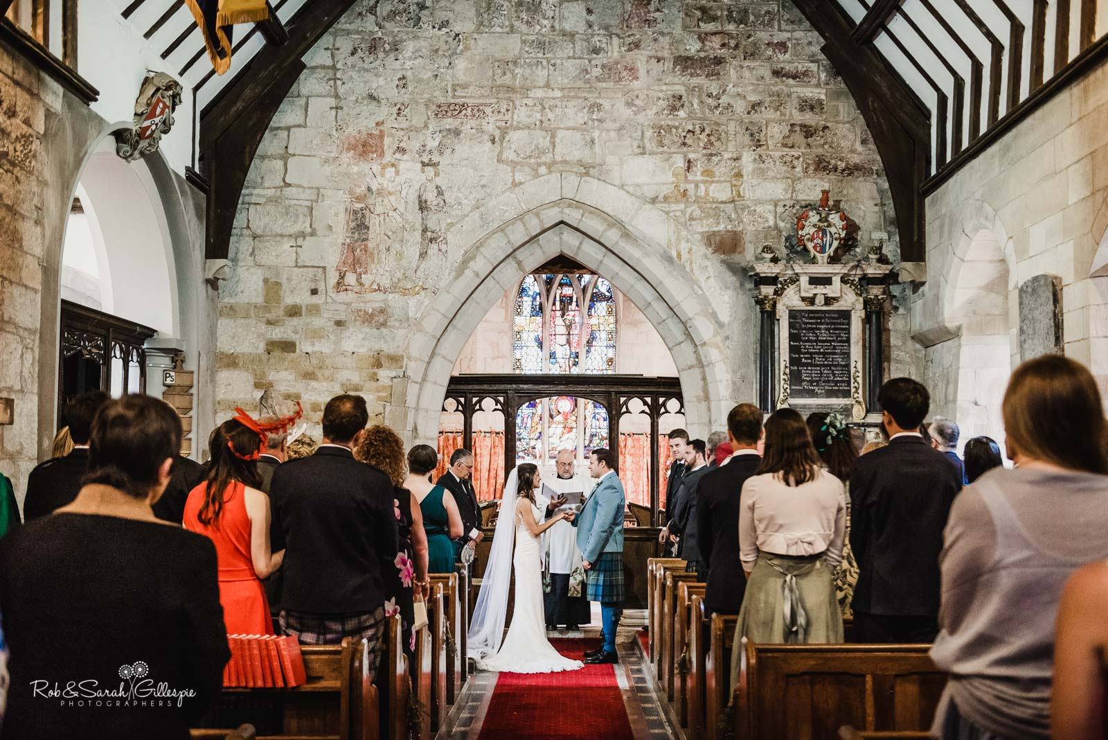 Bride and groom get married at St Giles church Packwood