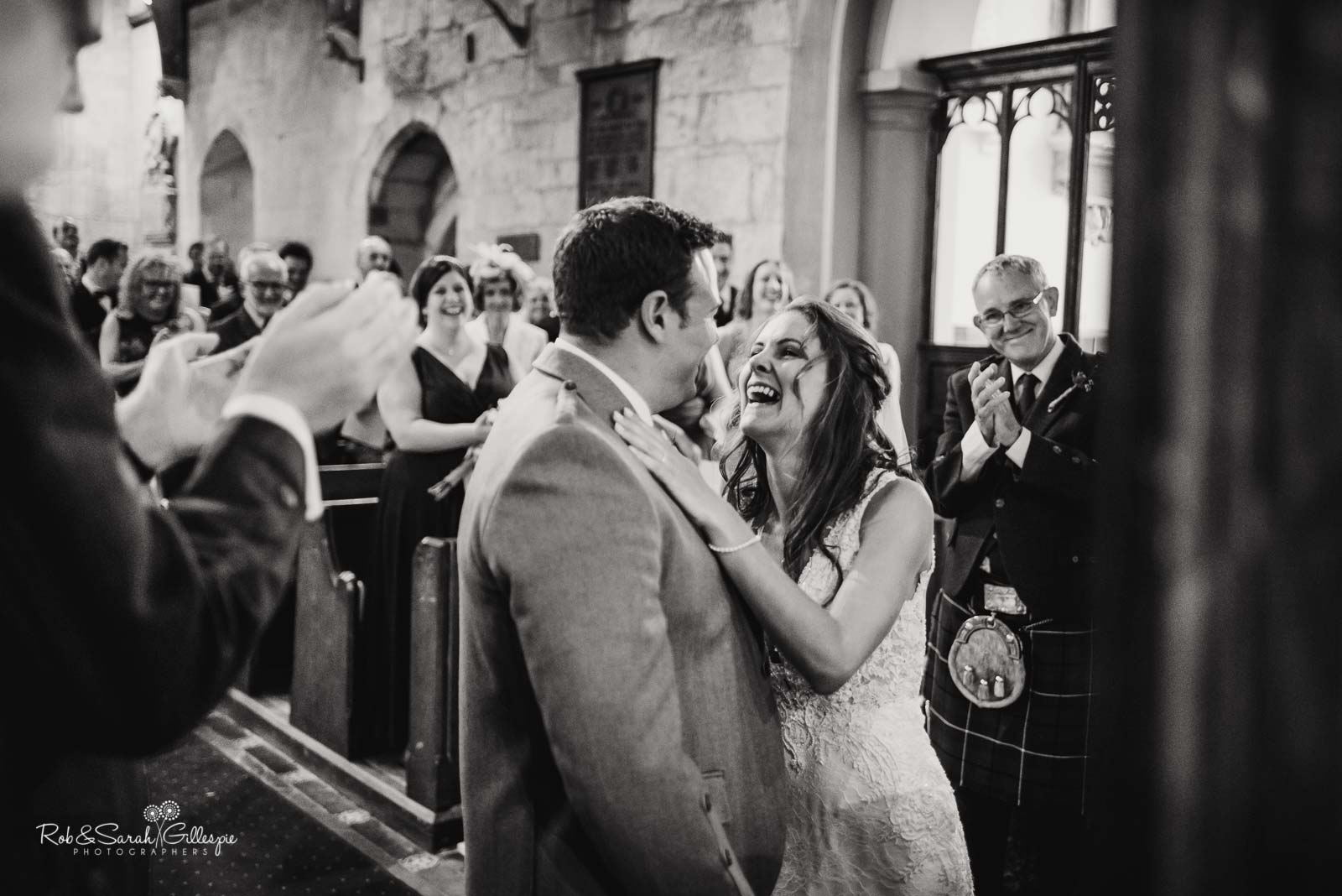 Wedding ceremony at St Giles church Packwood in Warwickshire