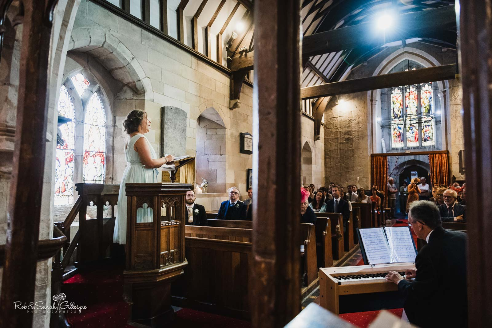 Weddinf guests sings at St Giles church Packwood