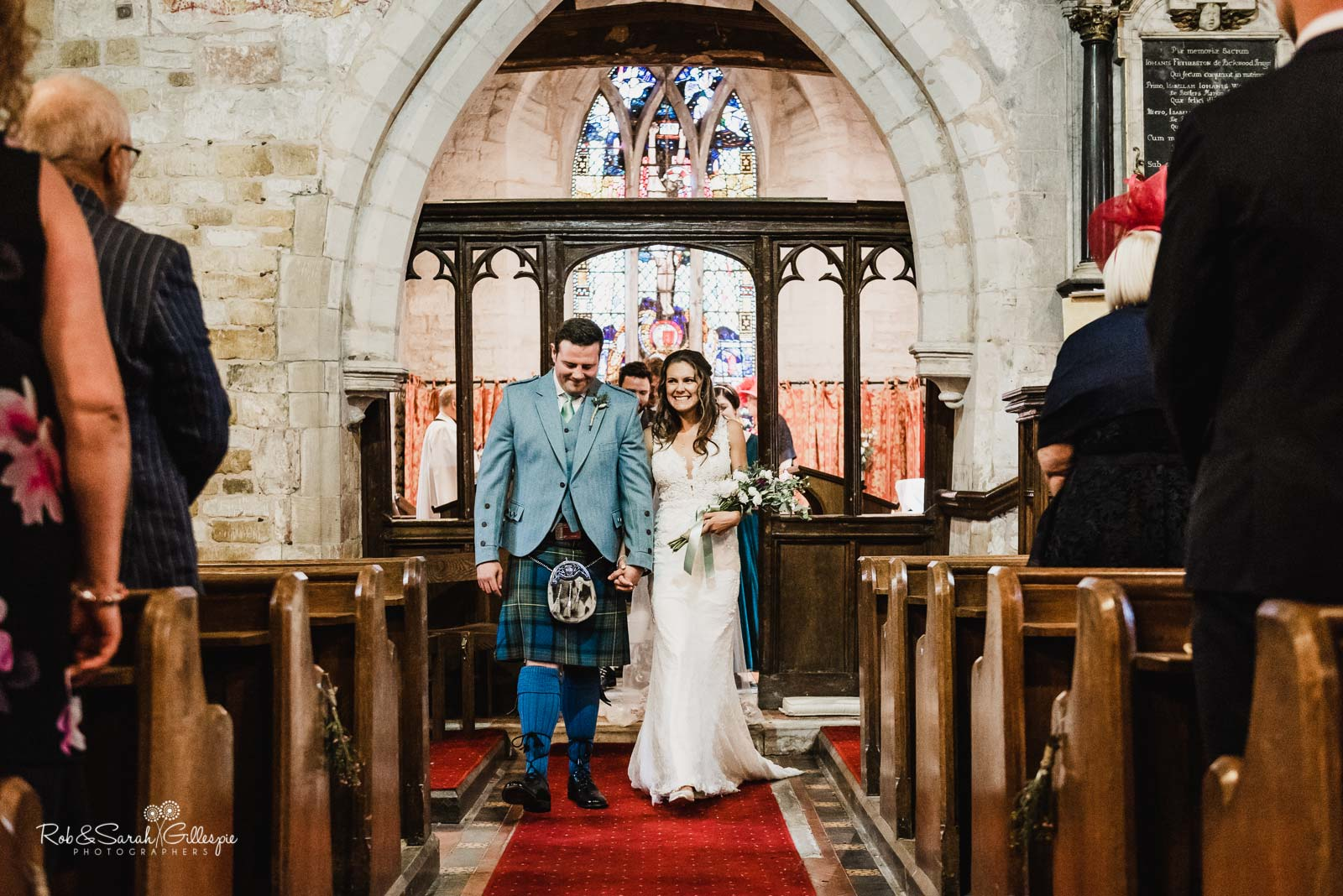 Bride and groom married at St Giles church Packwood in Warwickshire