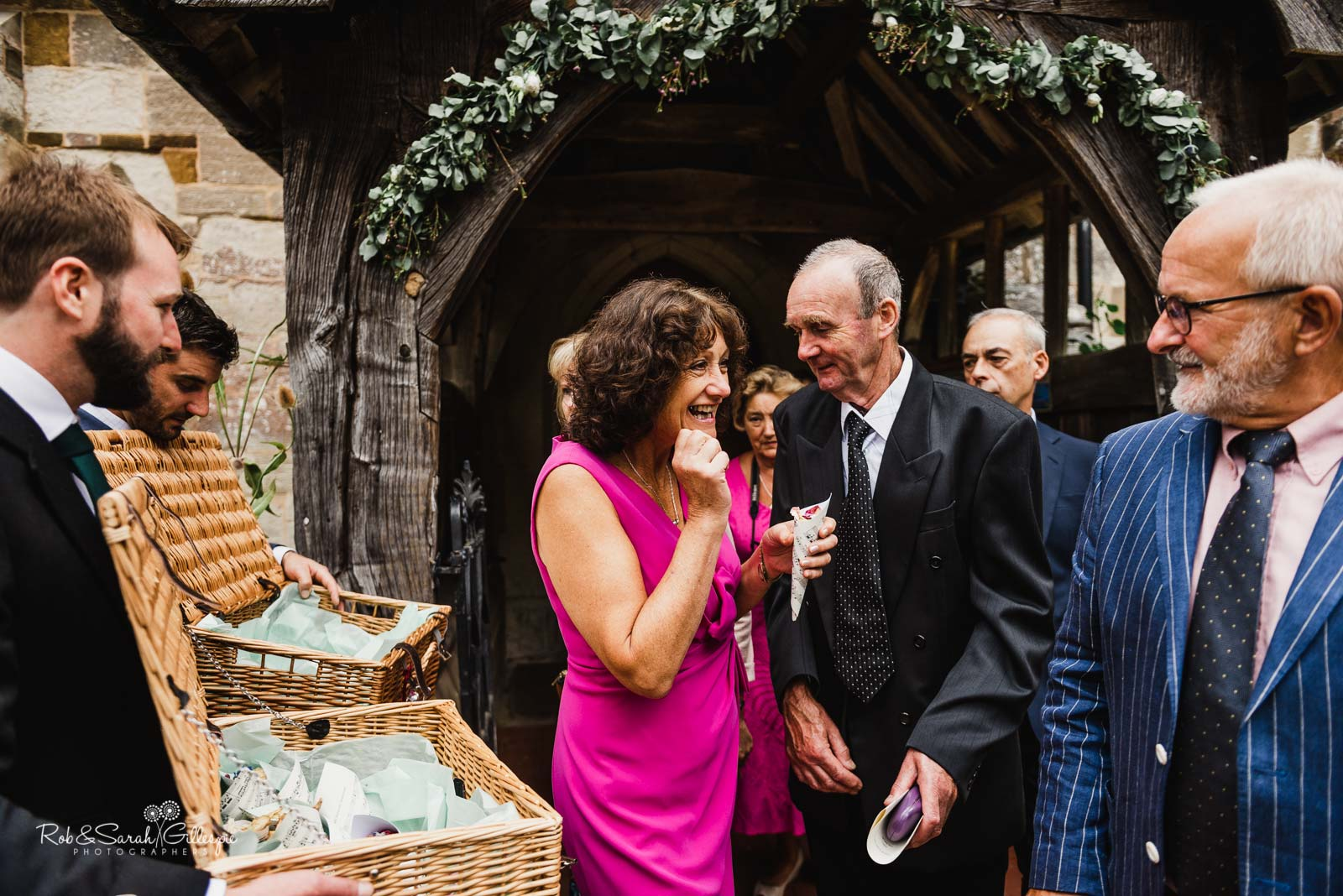 Wedding guests at St Giles church Packwood