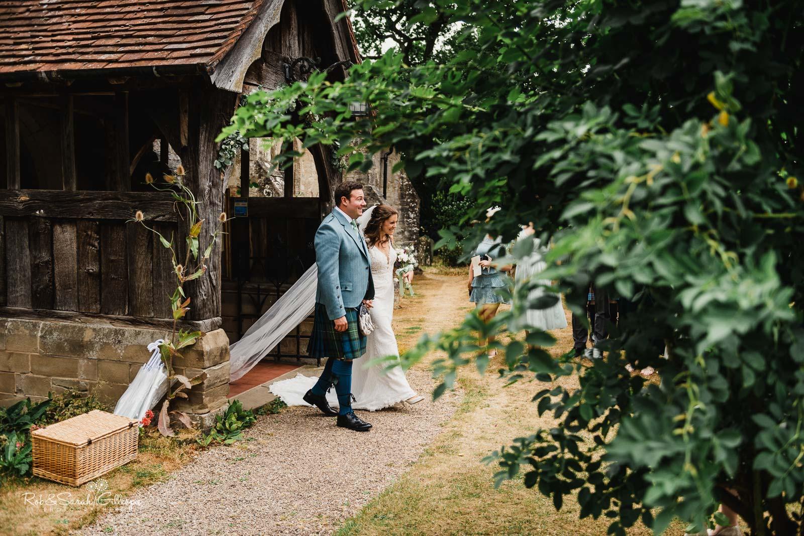 Bride and groom married at St Giles church Packwood