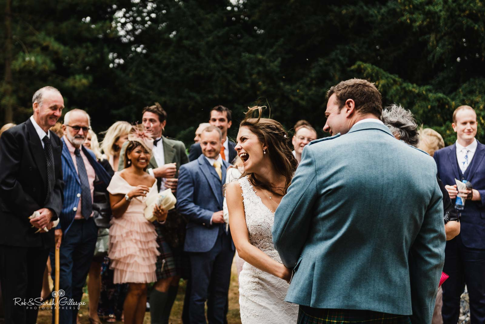 Bride and groom congratulated by wedding guests at St Giles church Packwood
