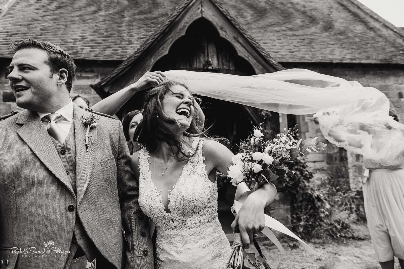 Documentary wedding photographers at St Giles church Packwood