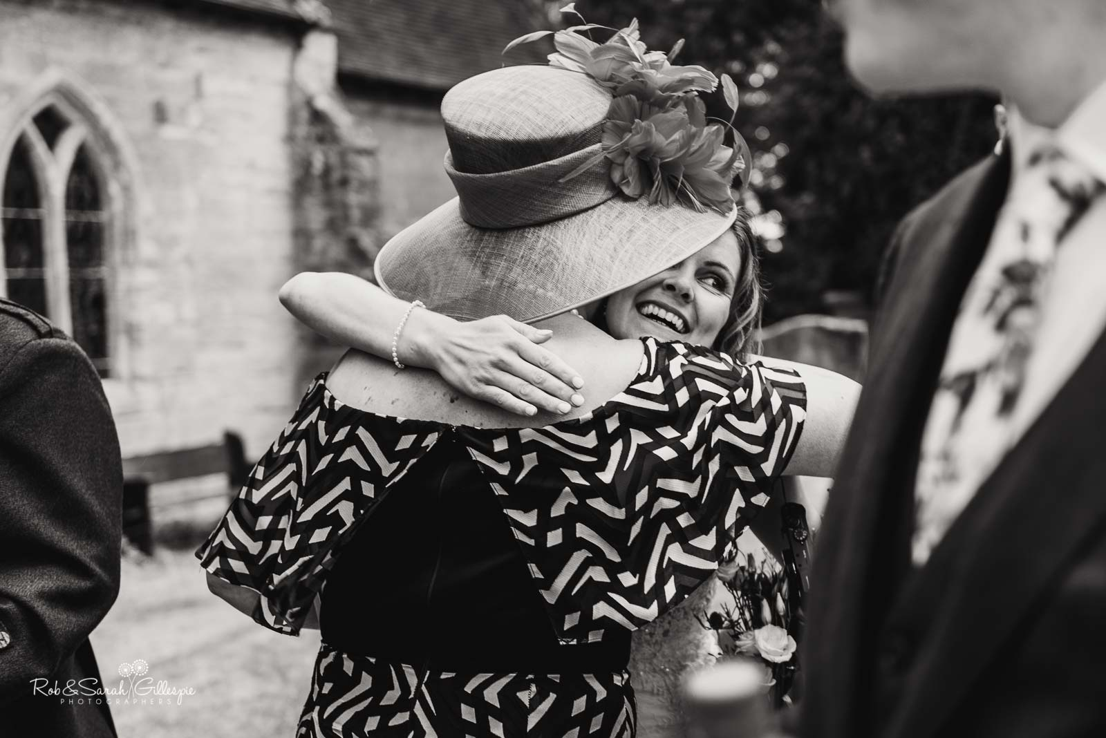 Wedding hugs at St Giles church Packwood