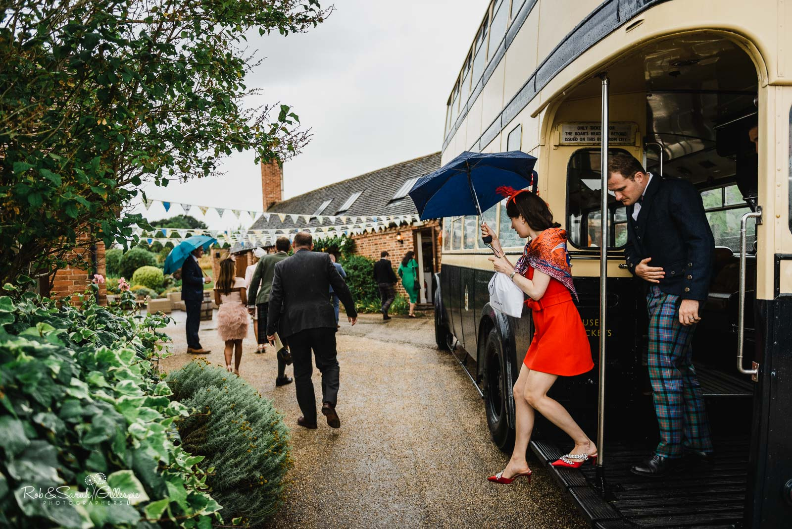 Wedding guests arrive on bus at Wethele Manor