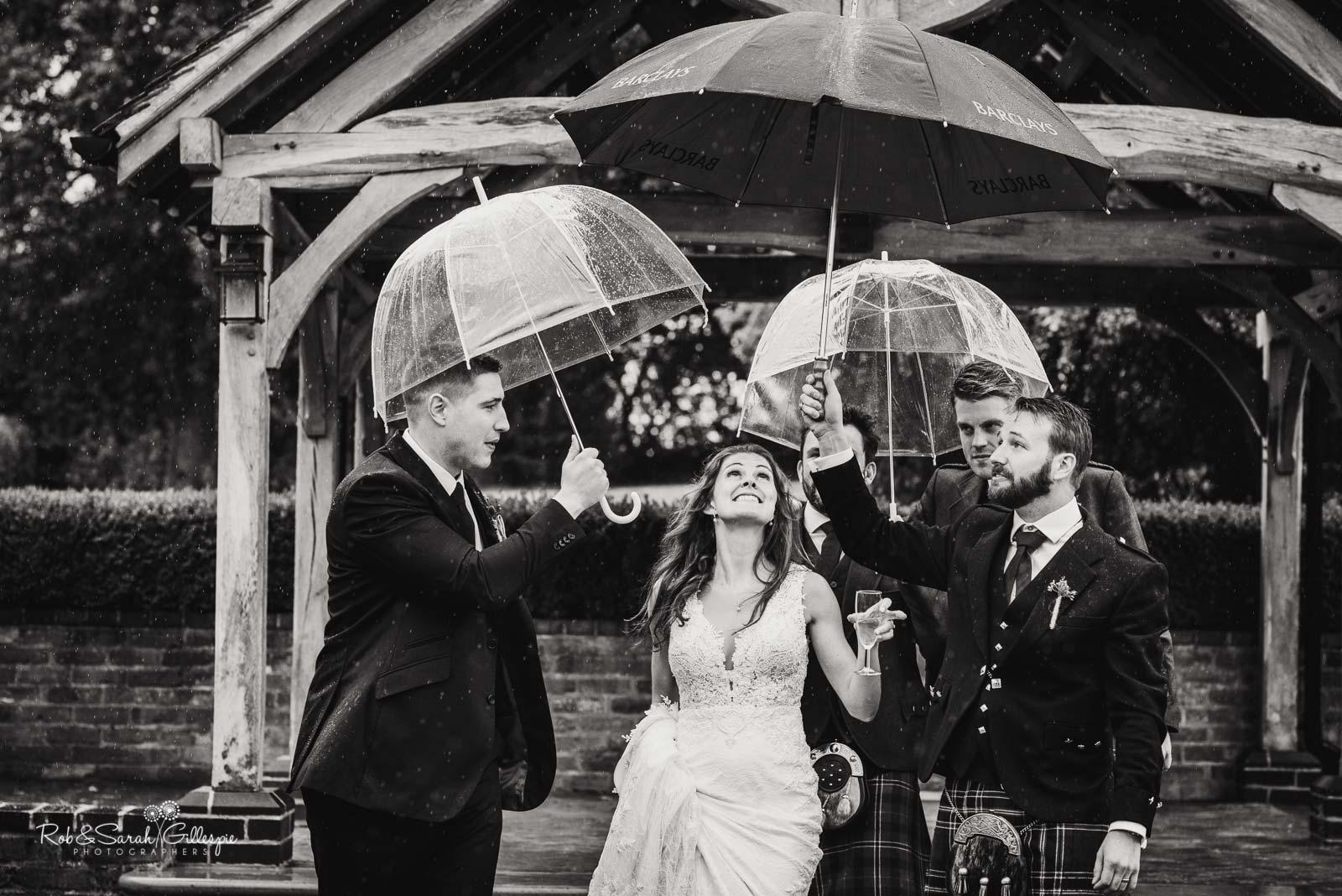Bride under umblrellas at Wethele Manor