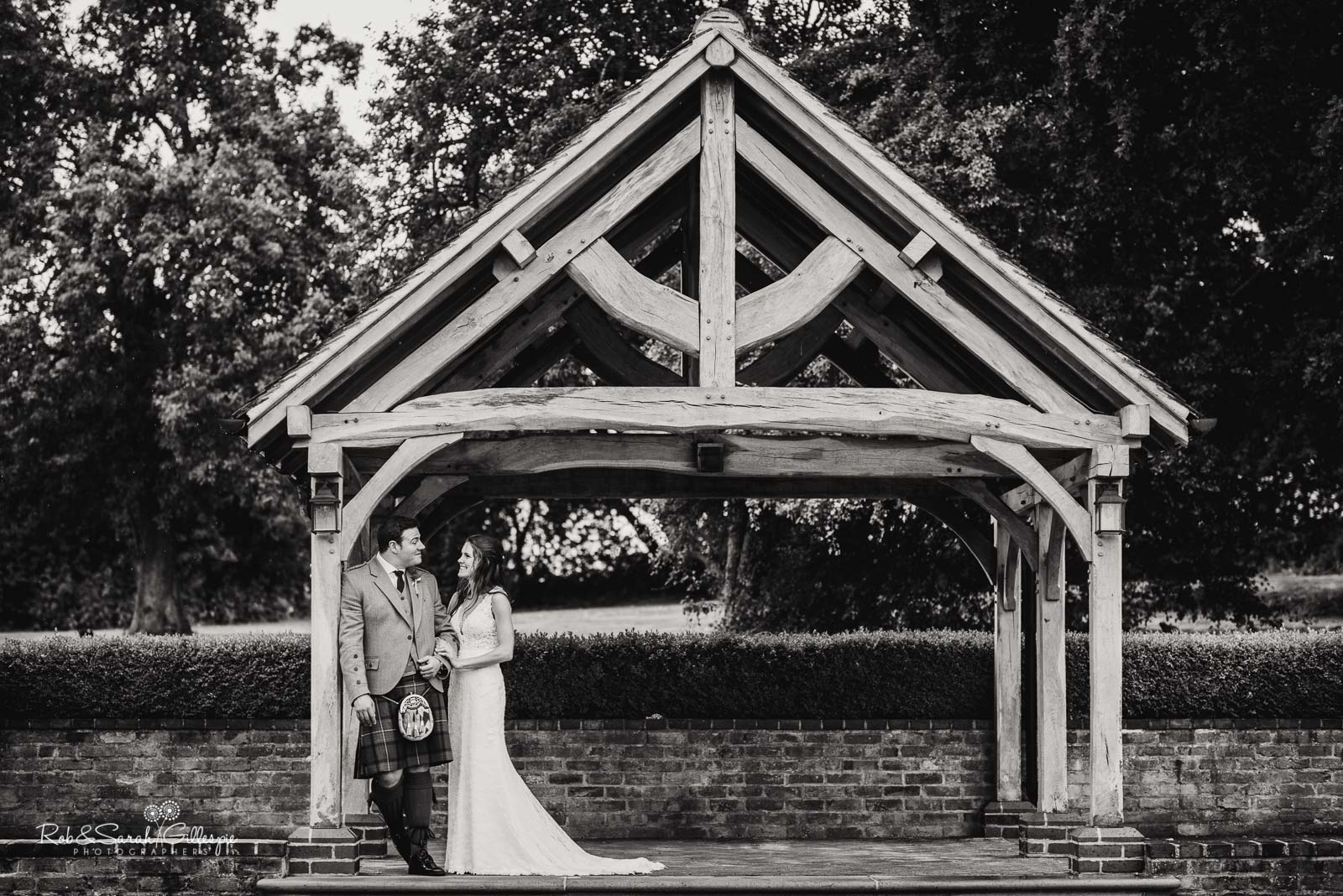 Bride and groom under Orchard Bothy at Wethele Manor