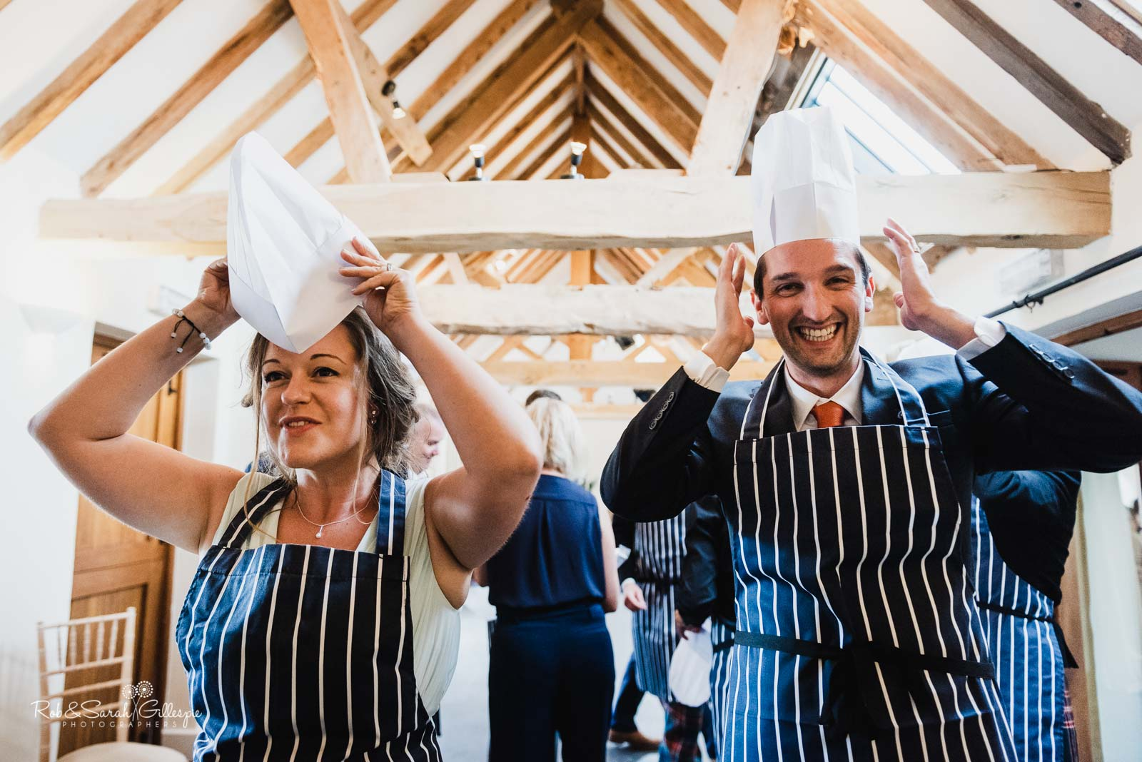 Guests put on chefs hats at Wethele Manor