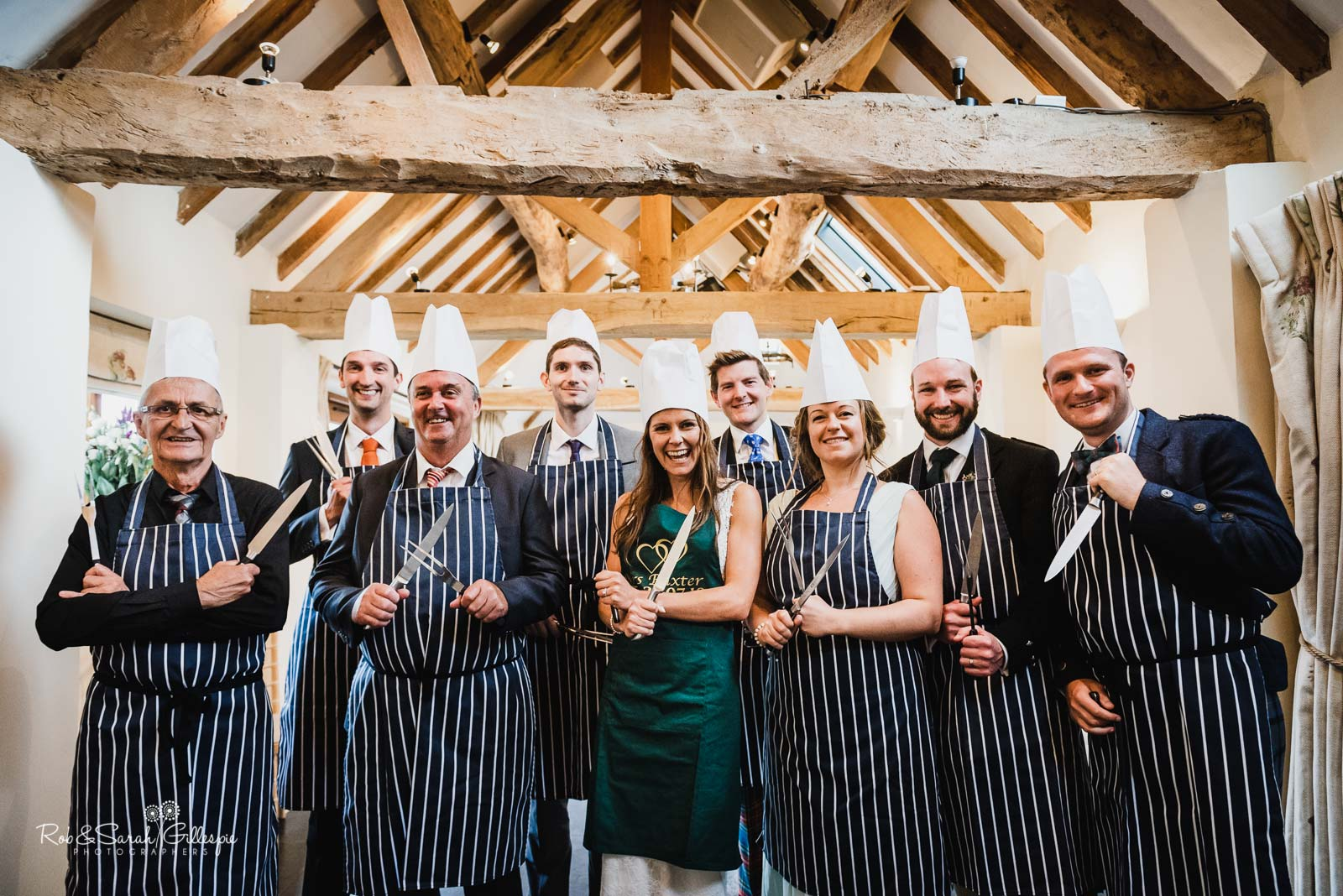 Bride and guests prepare to slice meat at Wethele Manor