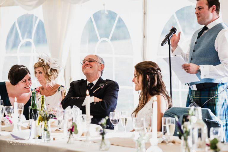 Wedding speeches in marquee