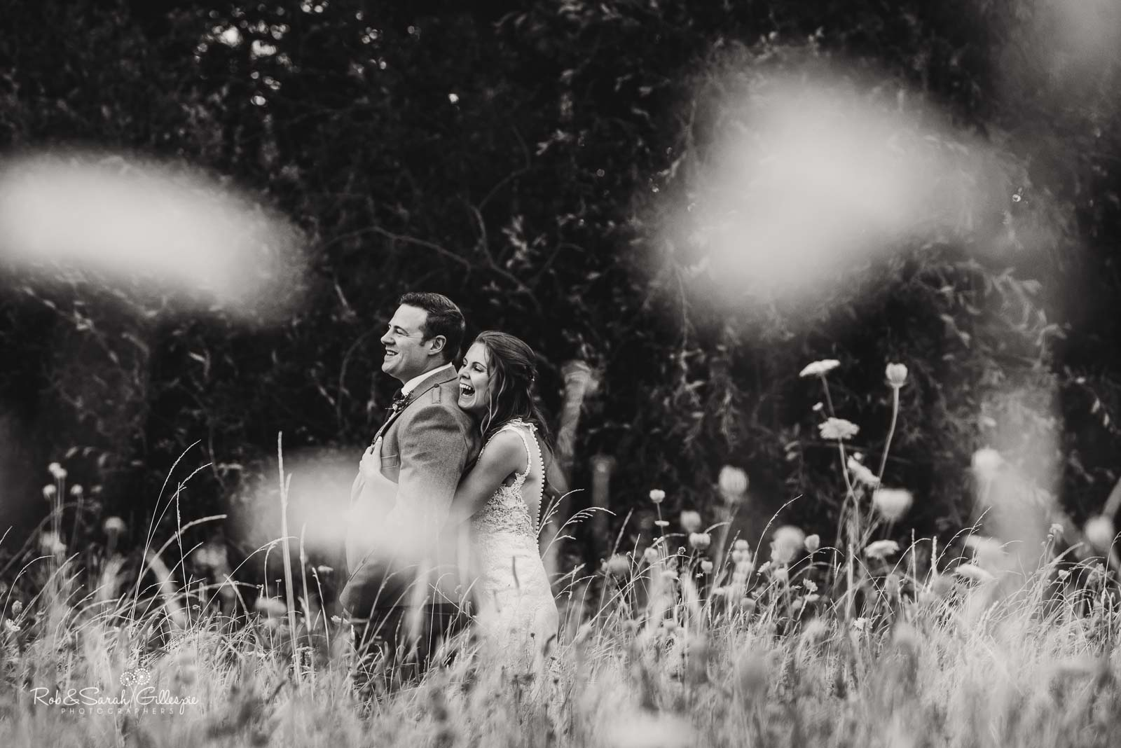 Bride and groom laughing together at Wethele Manor wedding