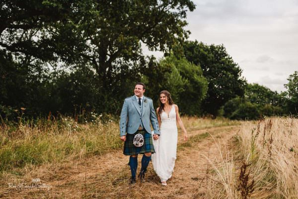 Bride and groom walking together at Wethele Manor