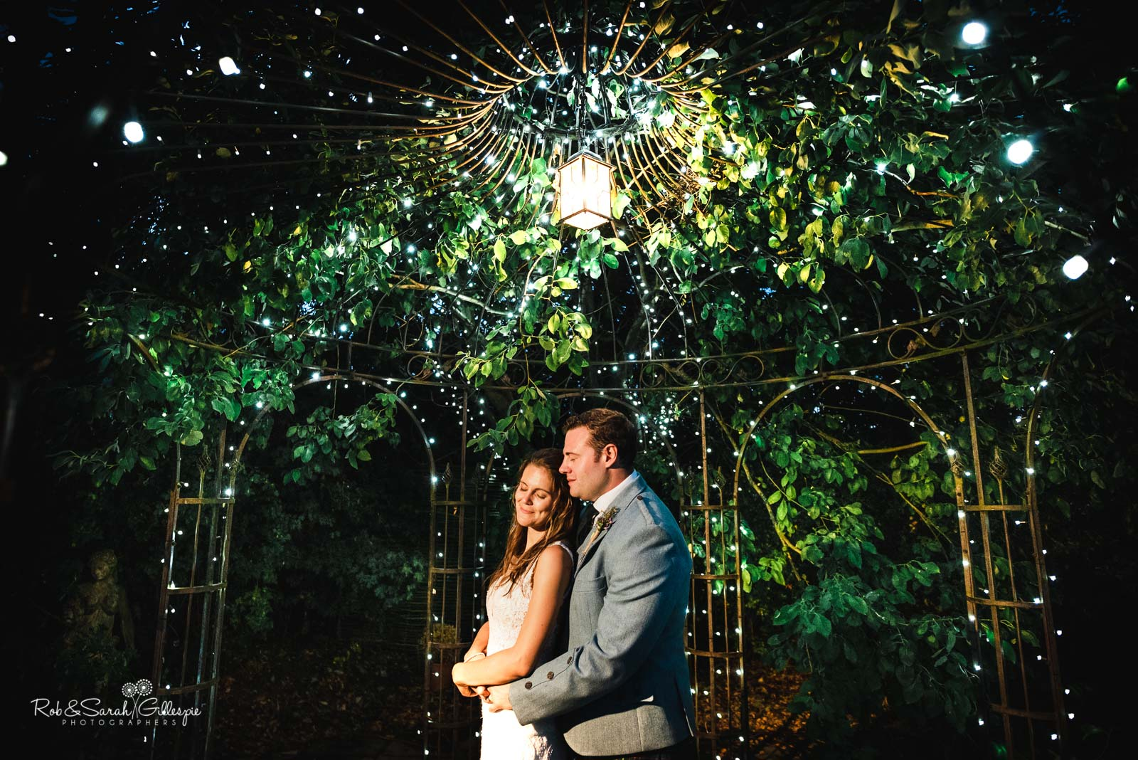 Bride and groom under gazebo at Wethele Manor