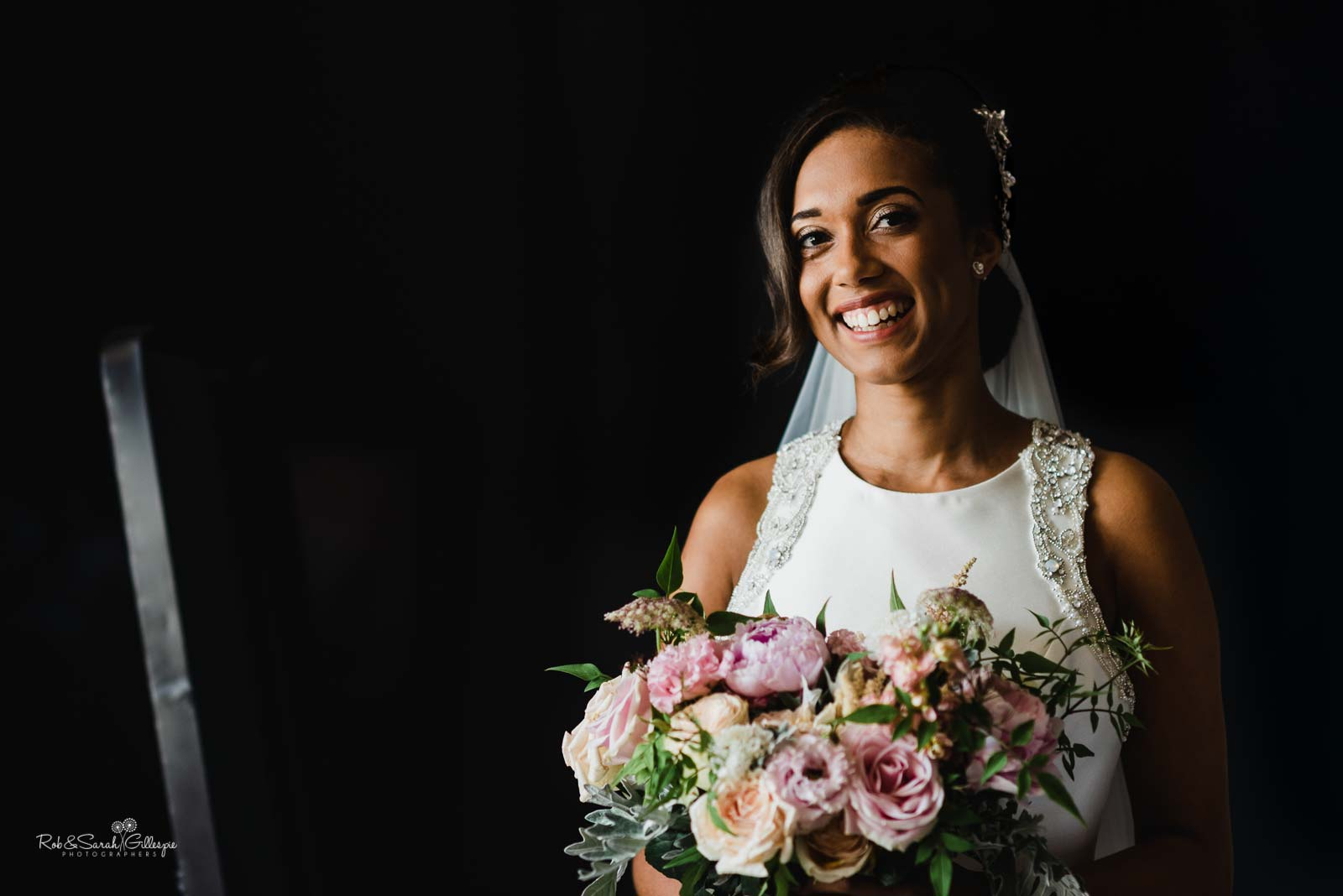 Bride laughing for portrait at Hampton Manor wedding