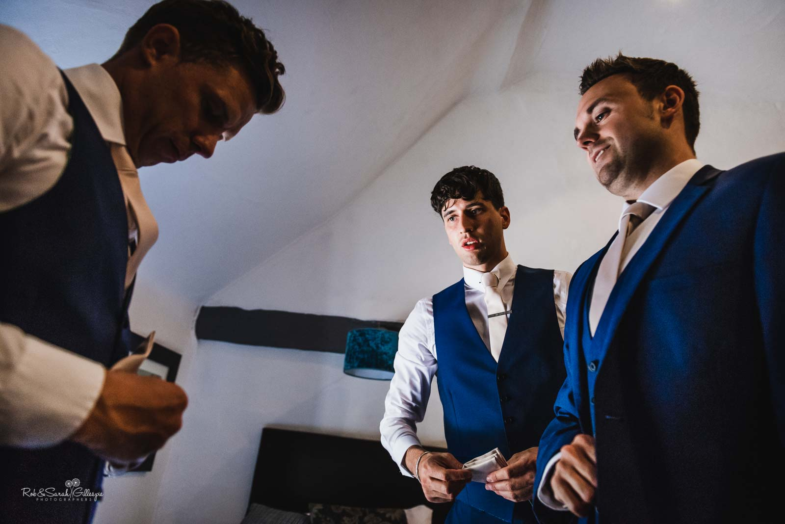 Groomsmen prepare for wedding at Hampton Manor