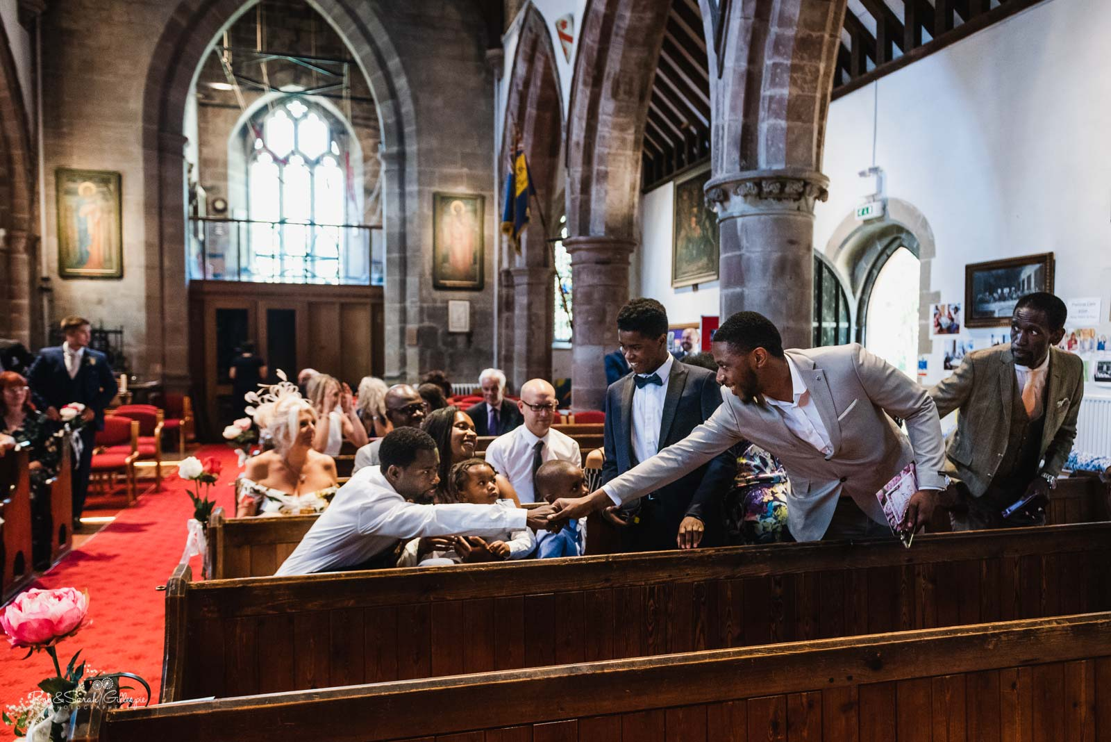 Wedding guests arrive at Hampton-in-Arden church