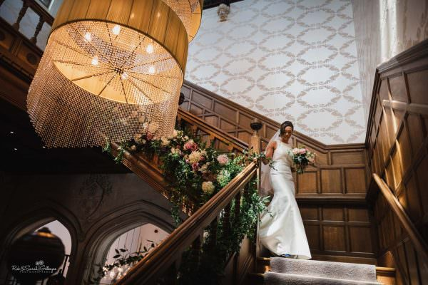 Bride on staircase at Hampton Manor