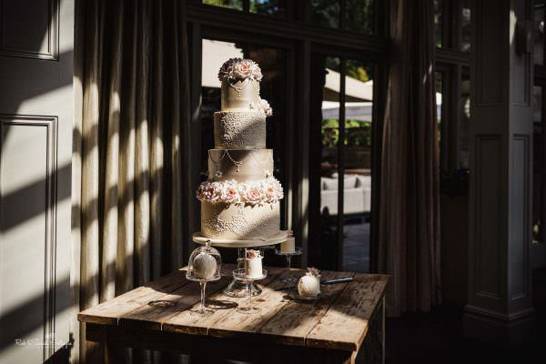 Wedding cake at Hampton Manor in strong light