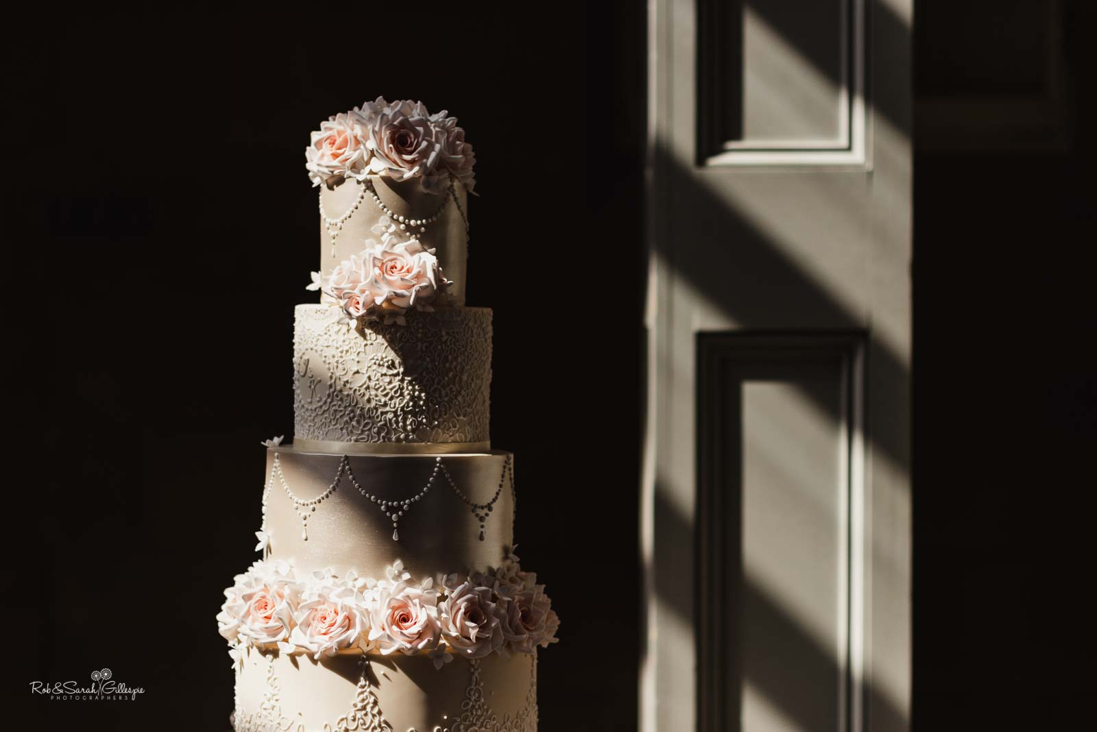 Wedding cake at Hampton Manor in strong sunlight