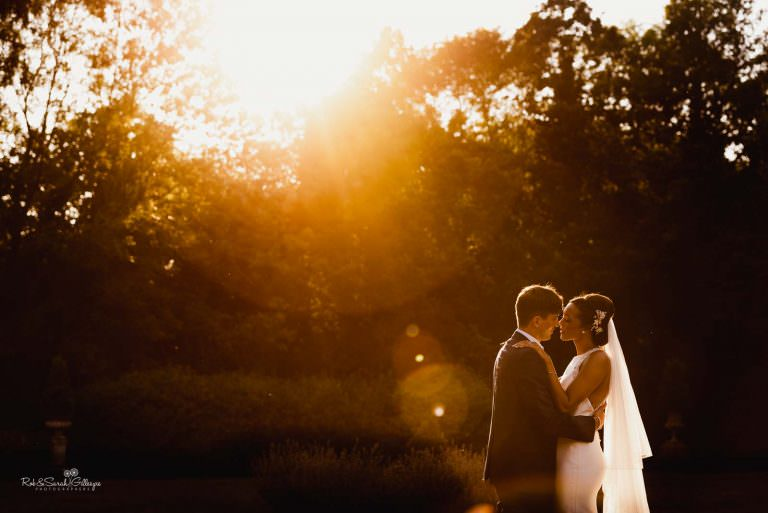 Bride and groom at Hampton Manor in beautiful evening light