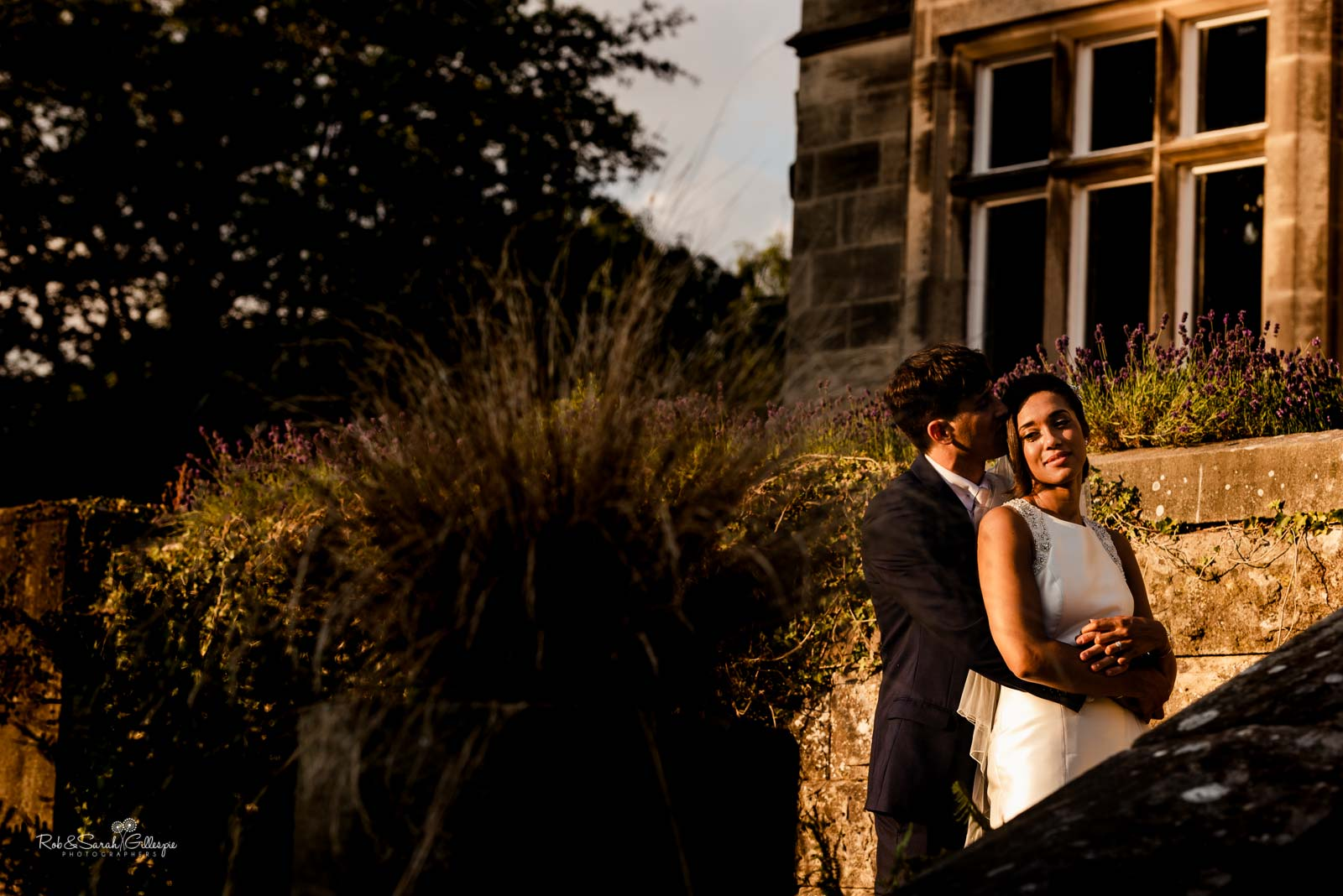 Bride and groom relaxing together in Hampton Manor grounds