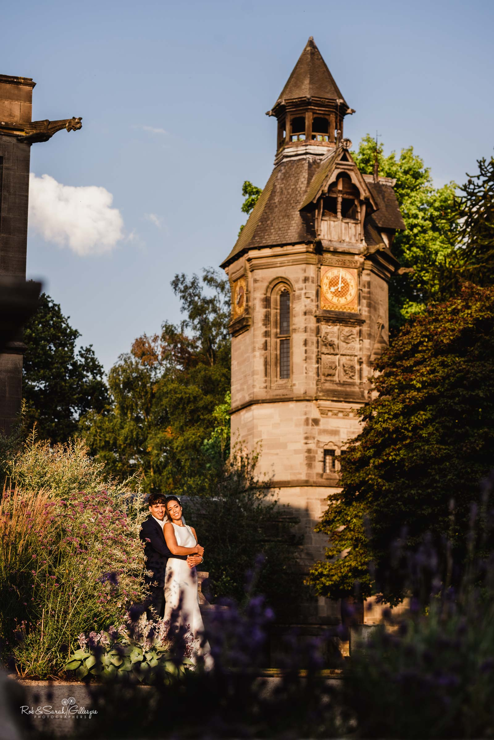 Hampton Manor clock tower with bride and groom
