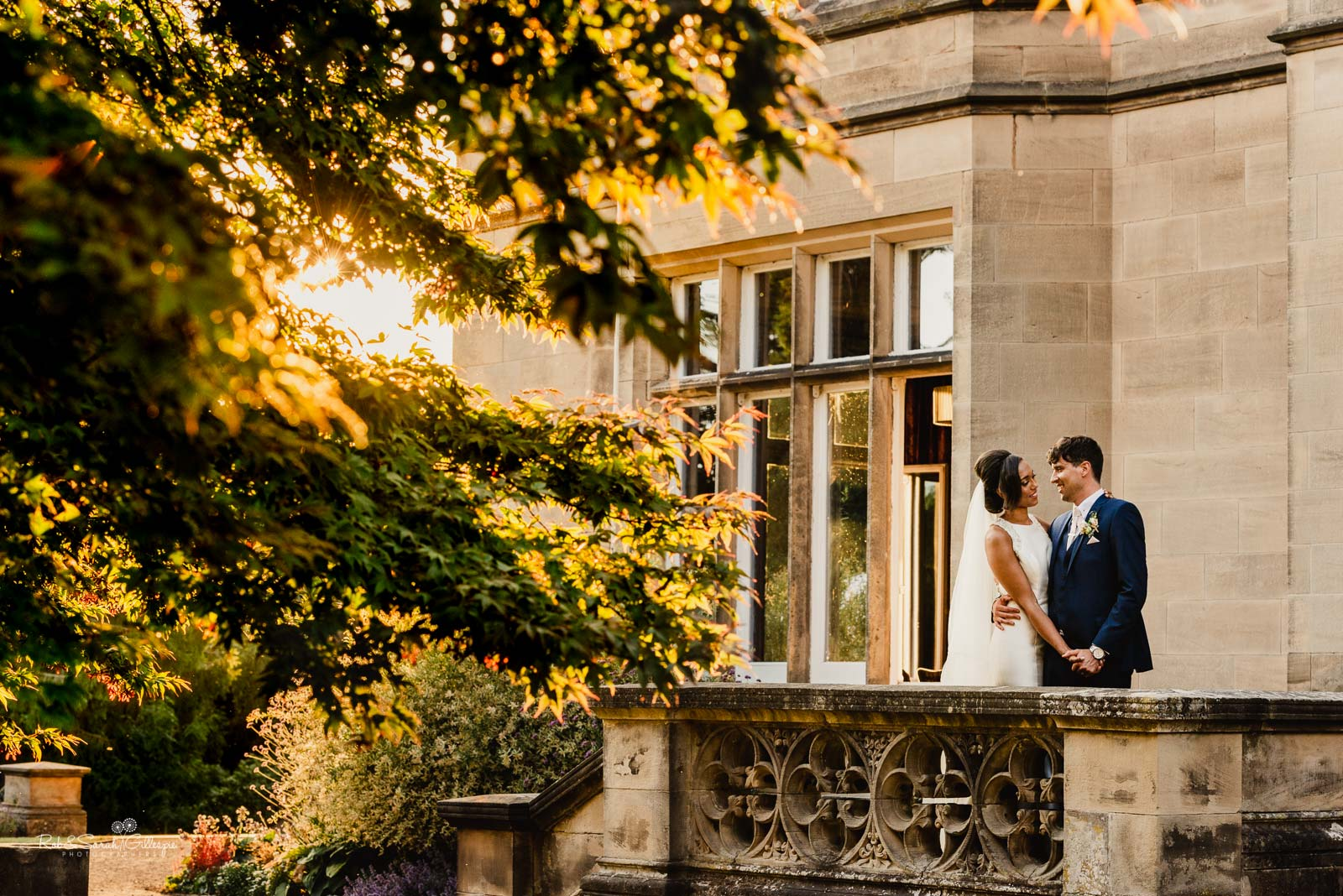 Bride and groom together at Hampton Manor in evening light