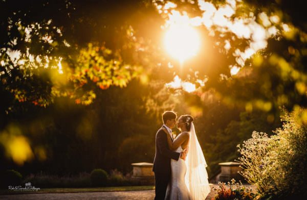 Beautiful photo of bride and groom in evening sunlight at Hampton Manor
