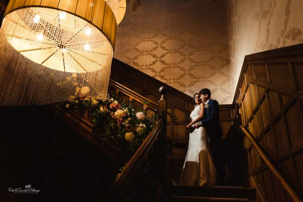 Hampton Manor staircase with bride and groom