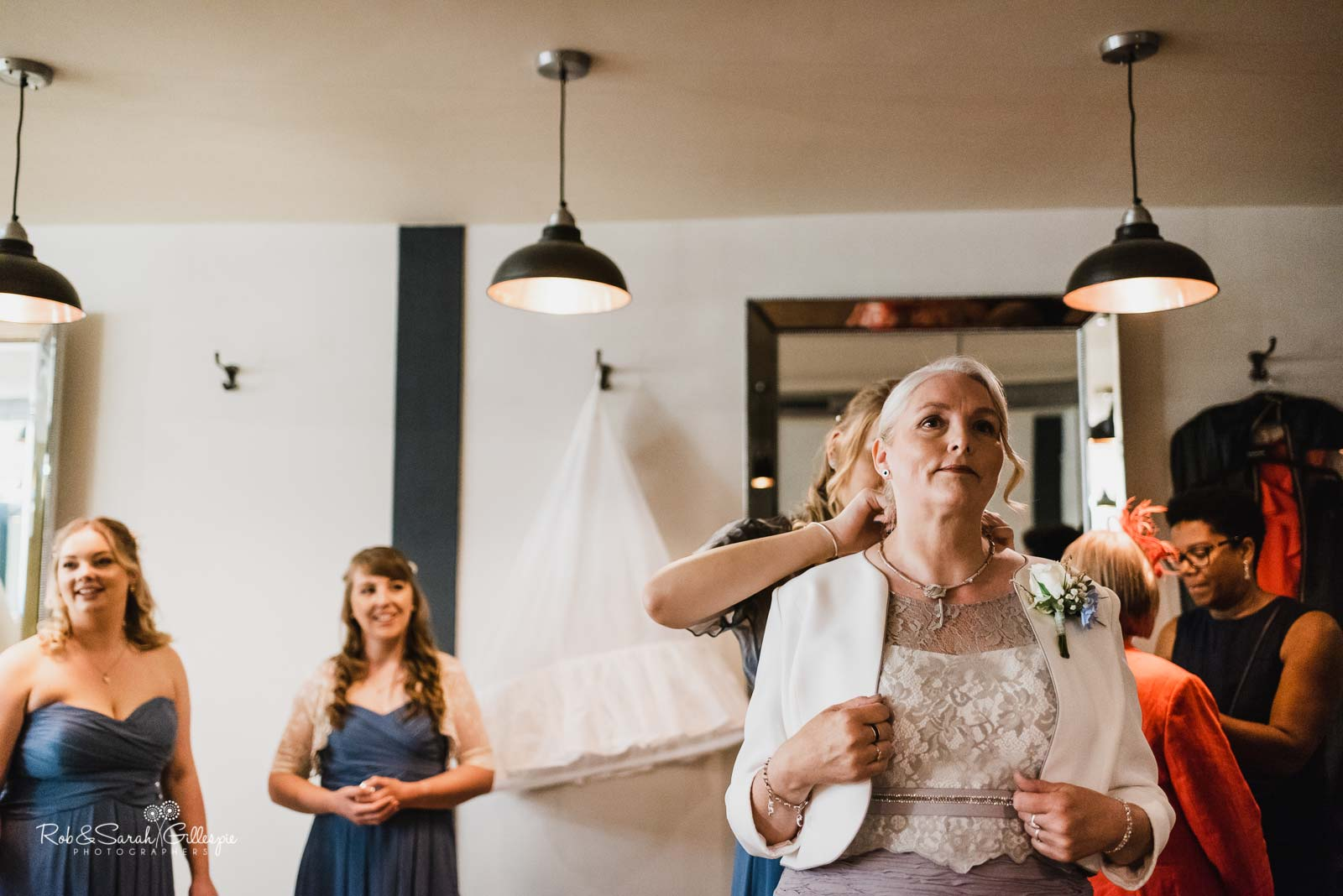 Bride's mum and bridesmaids get ready for wedding at The Mill Barns