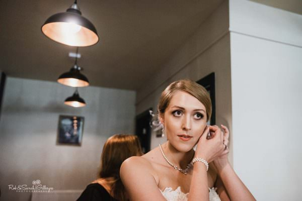 Bride getting ready for wedding at The Mill Barns