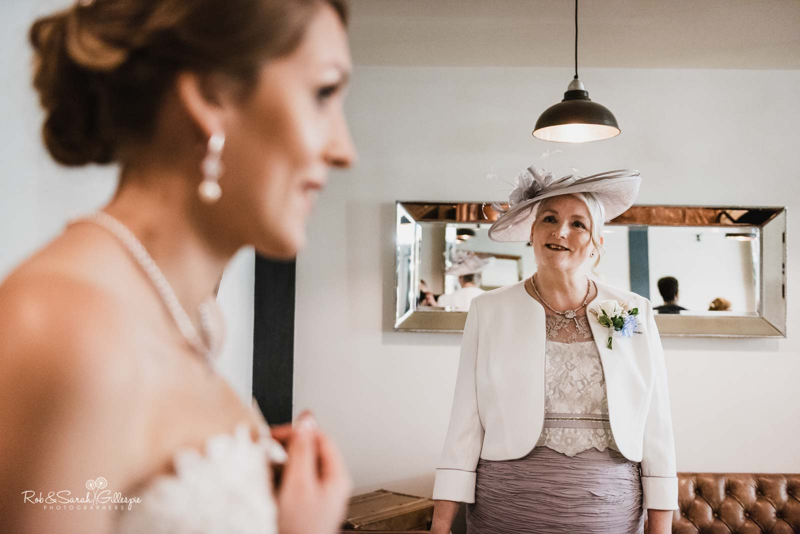 Mom smiles as daughter prepares for wedding at The Mill Barns