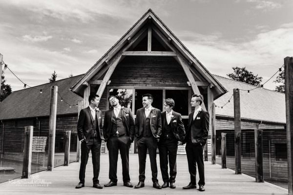 Group photo of groom and ushers at The Mill Barns wedding venue