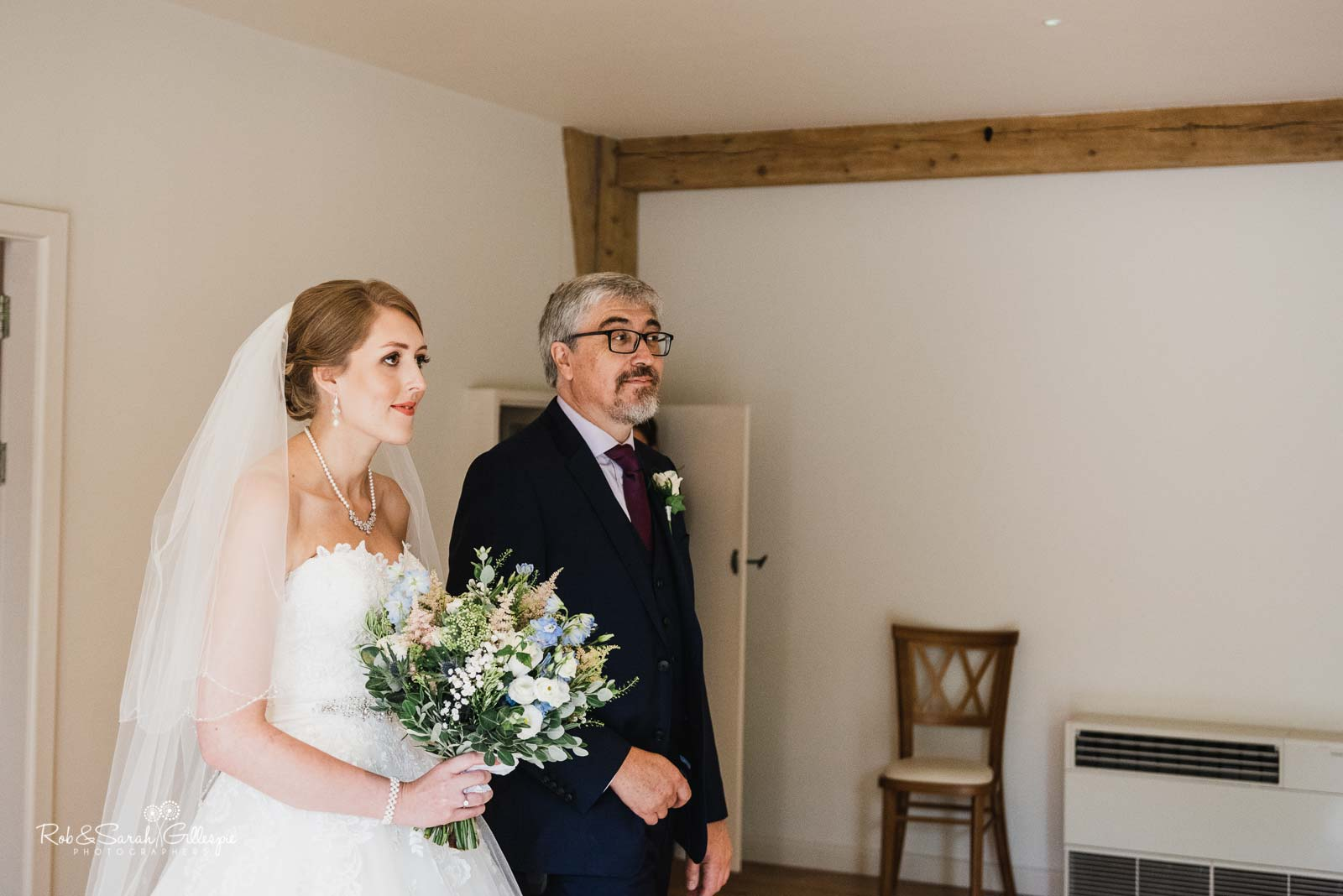Bride and father enter ceremony at The Mill Barns wedding