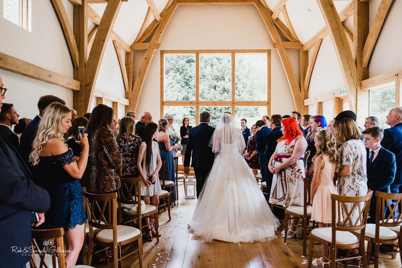 Bride and dad walk up the aisle at The Mill Barns wedding