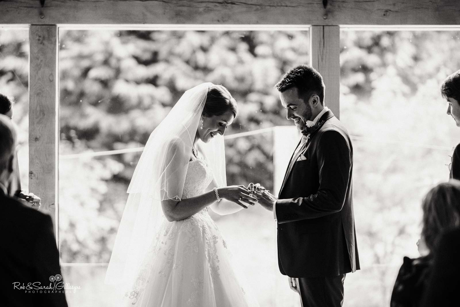 Bride and groom exchange rings at The Mill Barns wedding ceremony