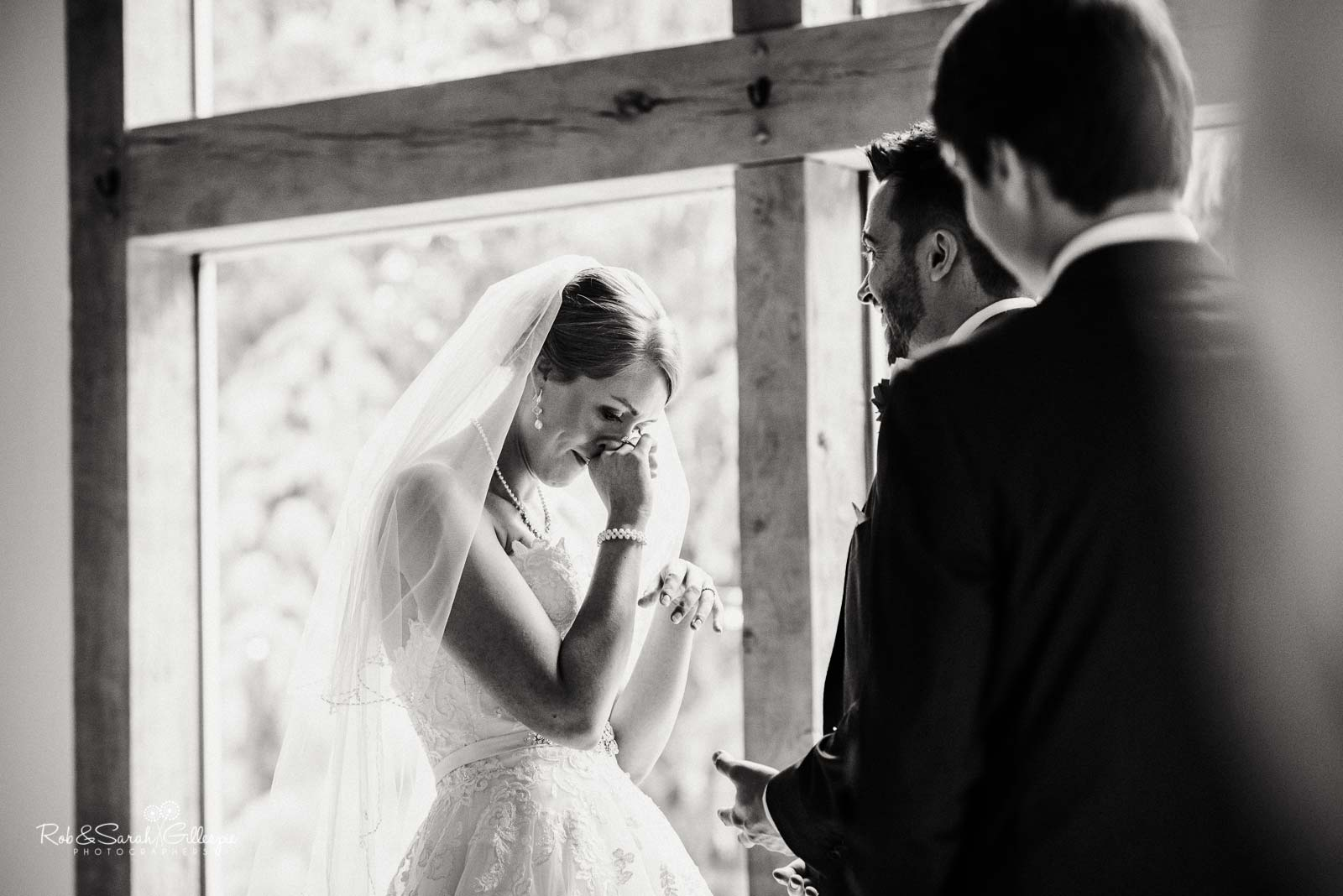 Bride emotional during ceremony at The Mill Barns wedding