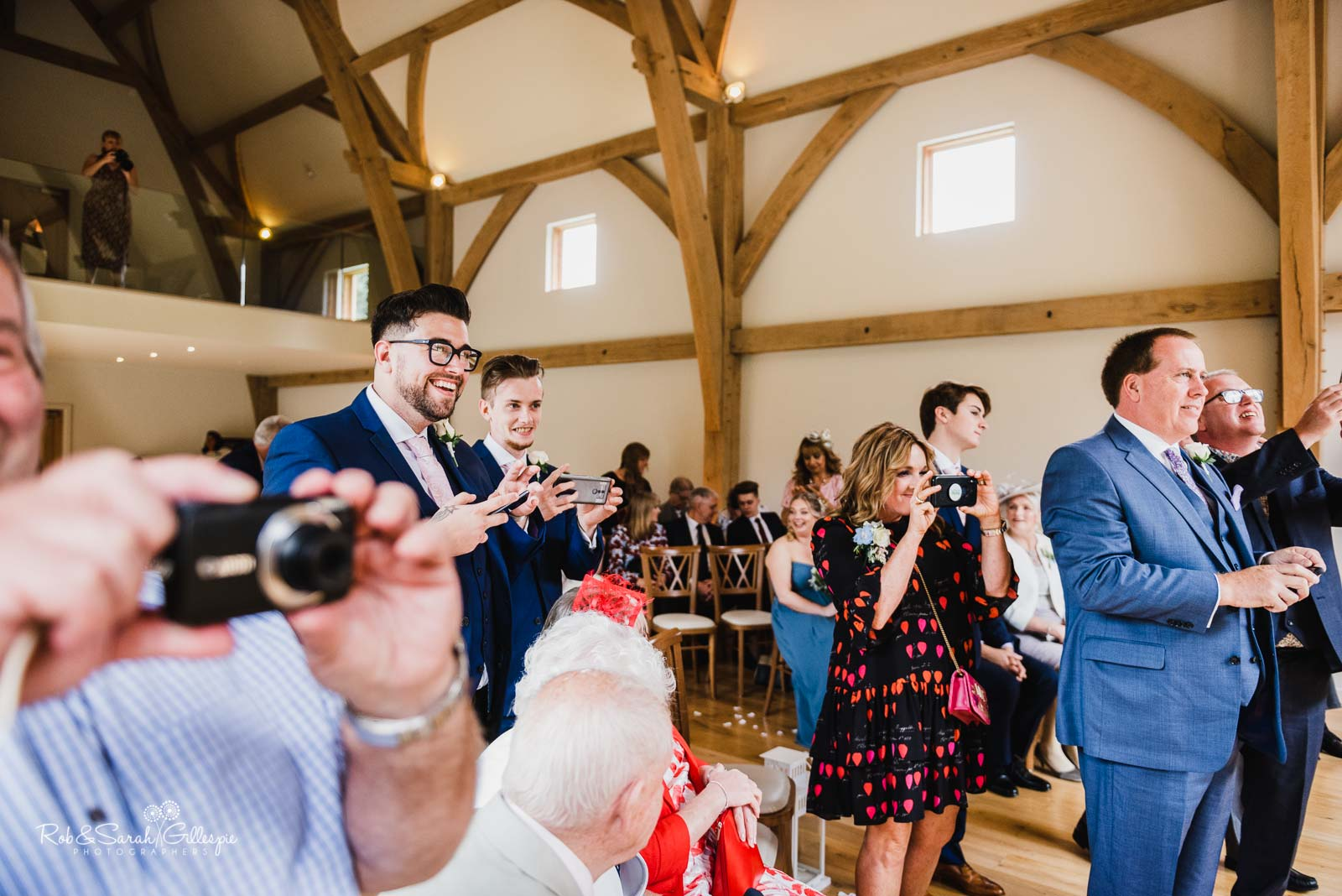 Wedding guests take pictures at The Mill Barns