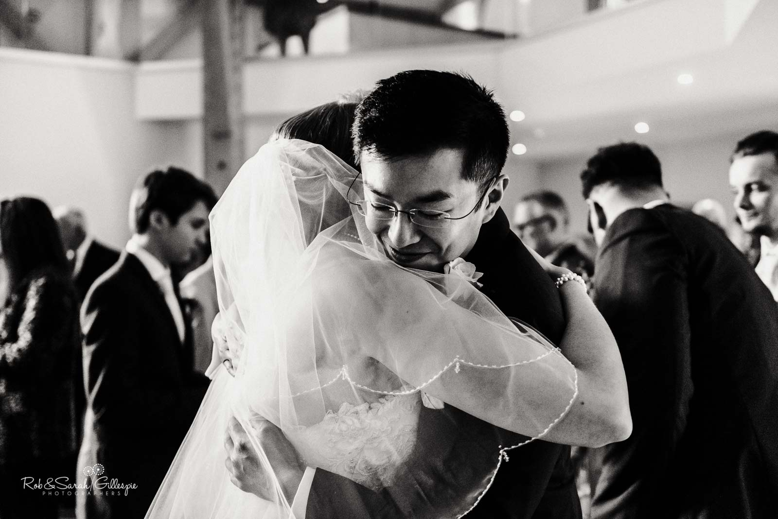 Wedding guest hugs bride at The Mill Barns