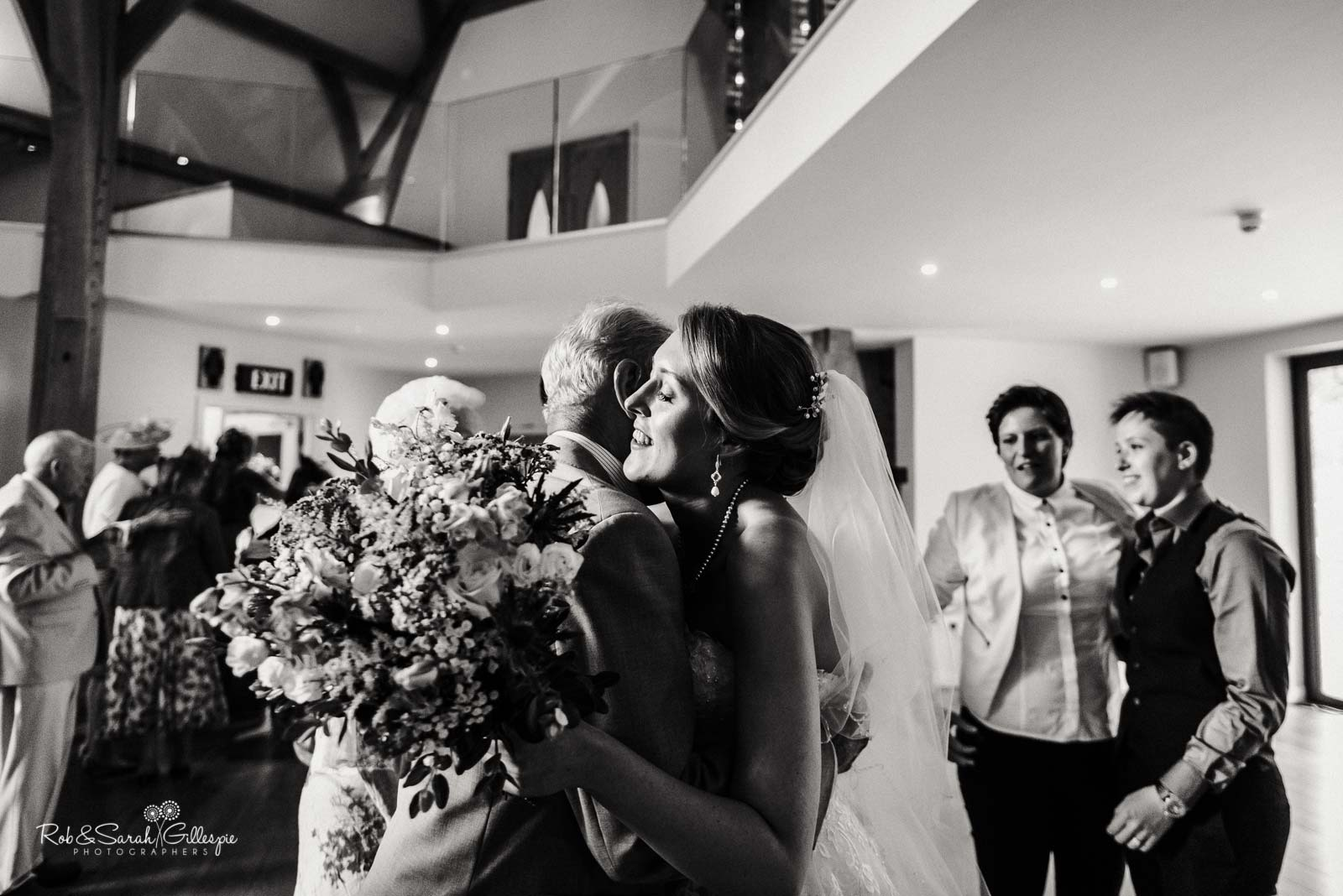 Bride hugs wedding guest at The Mill Barns