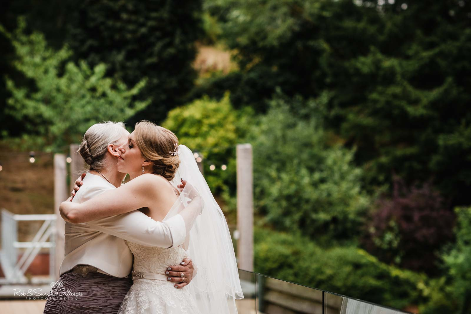 Bride hugs mum at The Mill Barns wedding