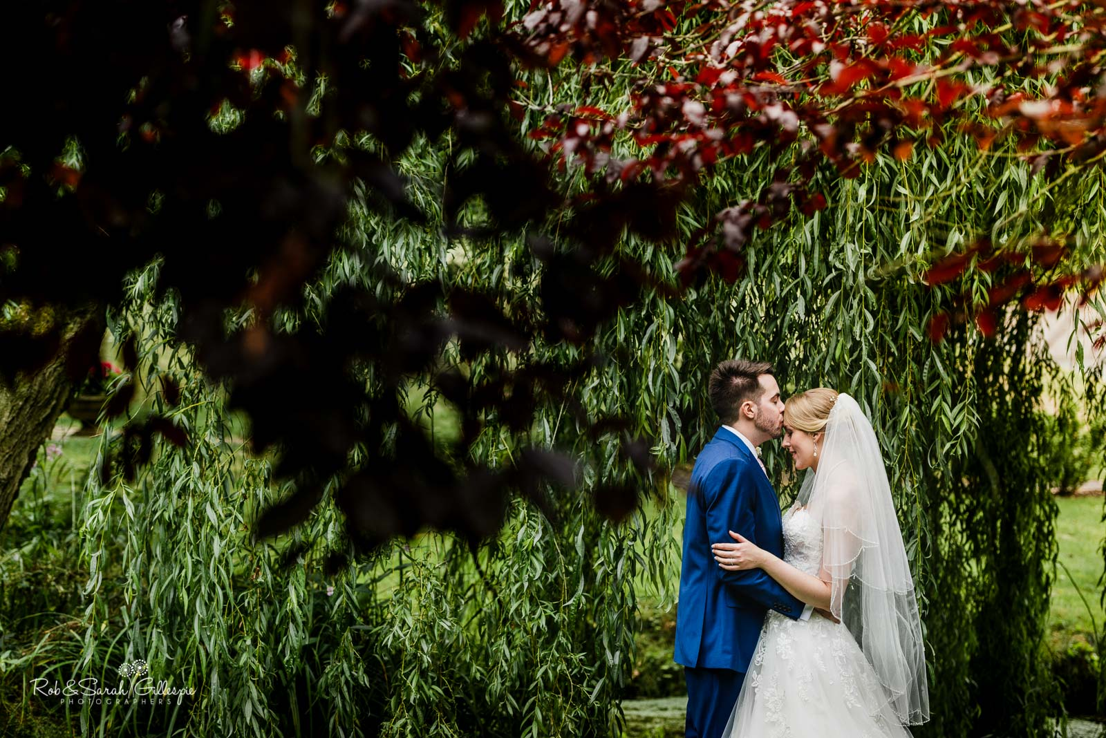 Bride and groom together in grounds at The Mill Barns