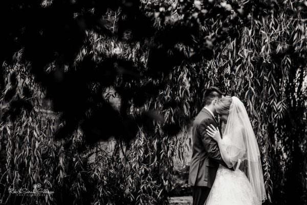 Bride and groom hug at The Mill Barns