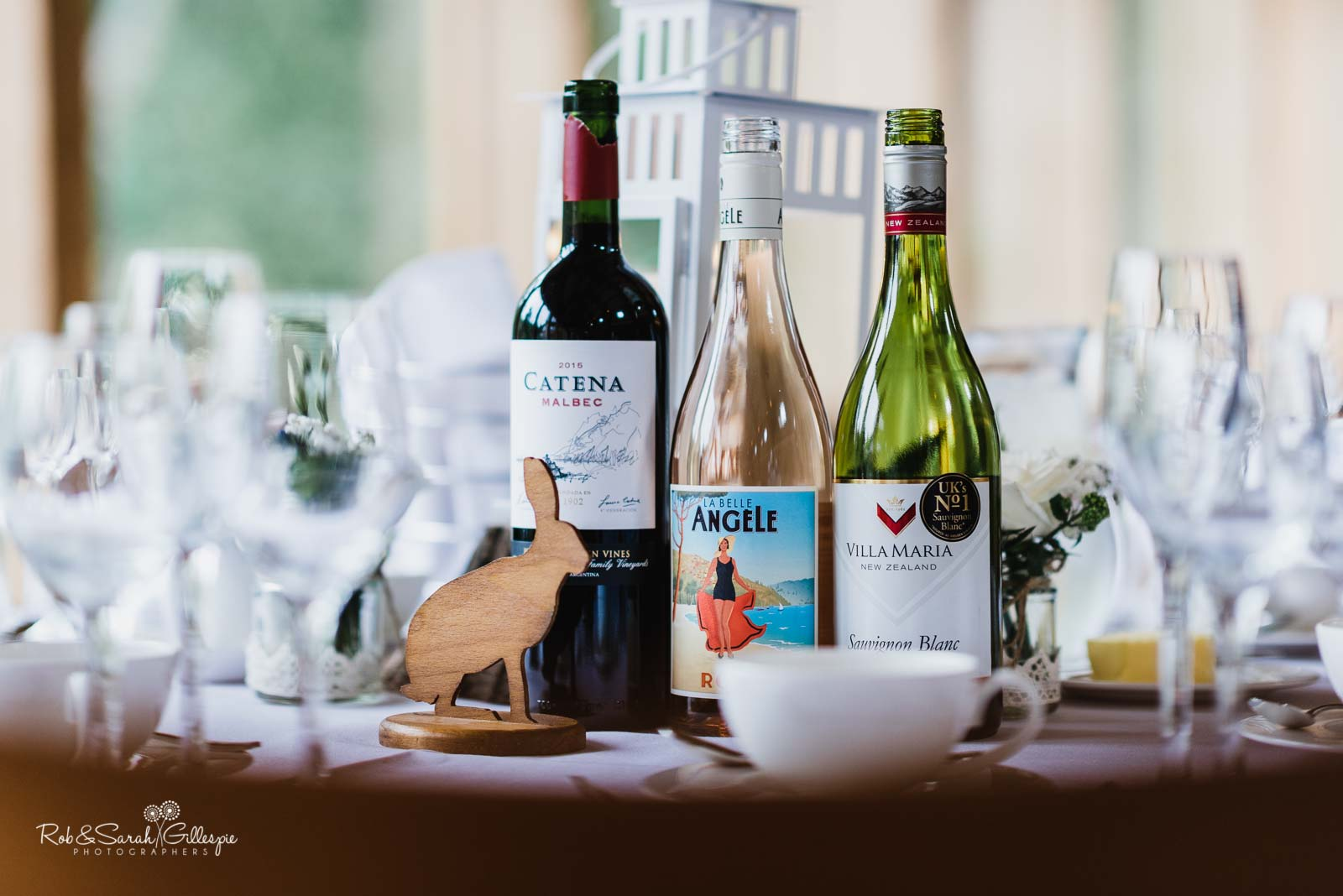 Bottles of wine and table details at The Mill Barns wedding