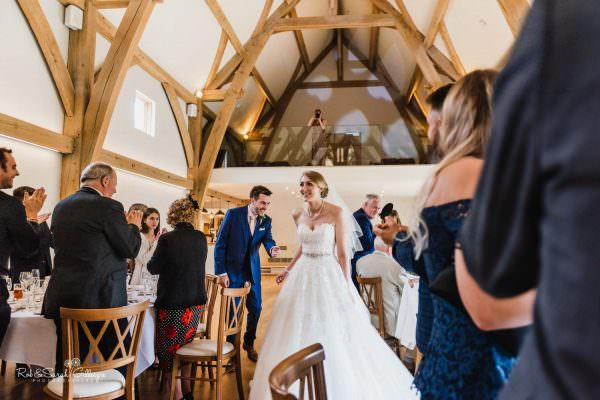 Bride and groom entrance for wedding breakfast at The Mill Barns