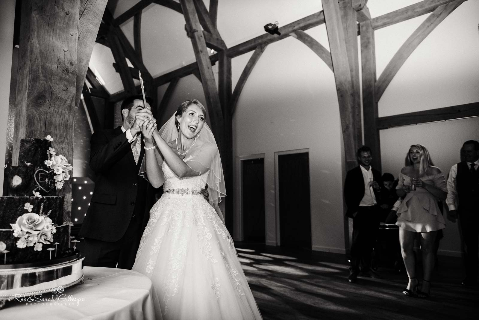 Cutting of the cake at The Mill Barns wedding