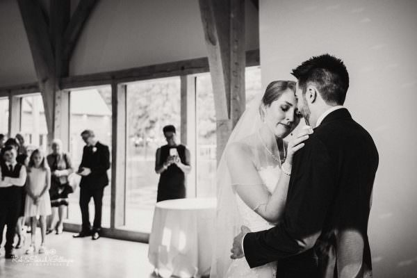 Bride emotional during first dance at The Mill Barns wedding