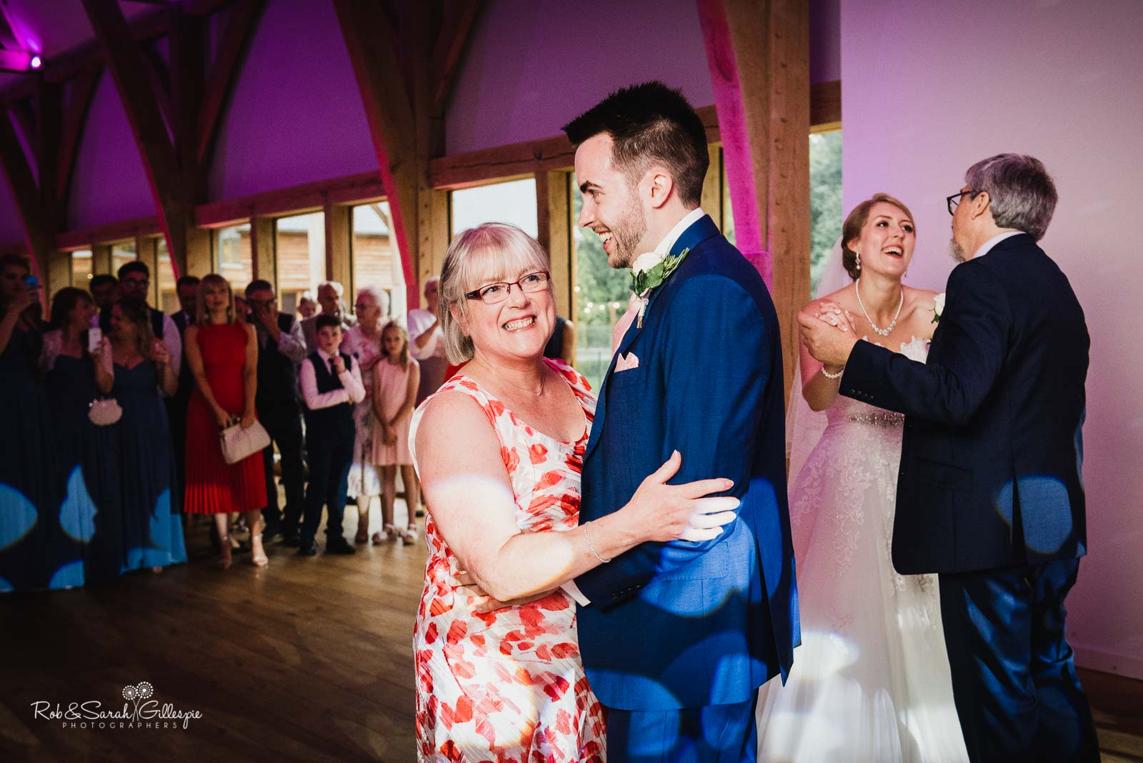 Bride and groom and parents dance at The Mill Barns wedding
