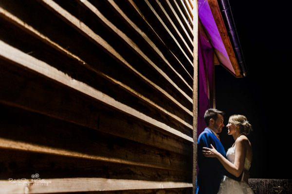 Bride and groom outside The Mill Barns at night